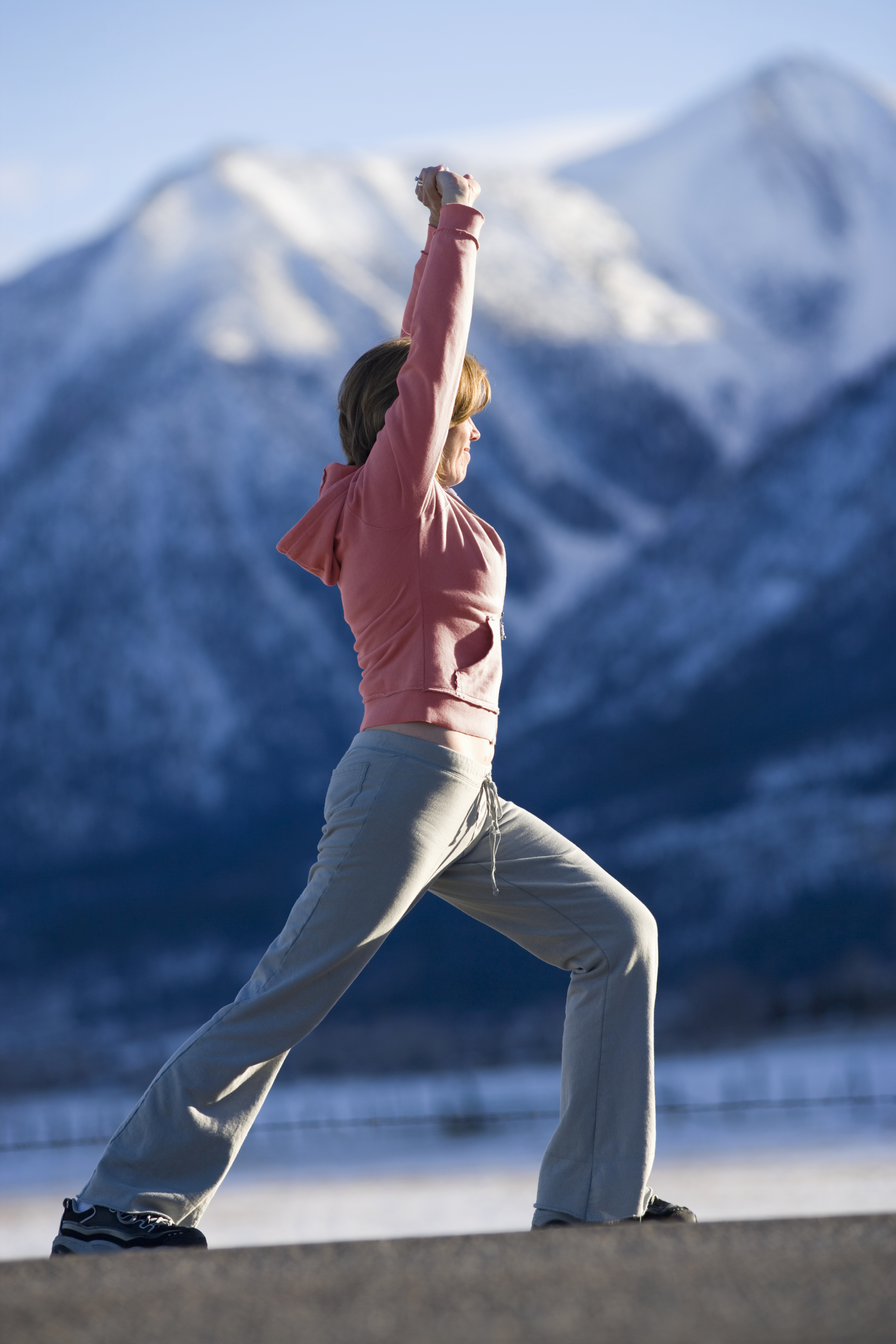 woman_stretching_on_mountain