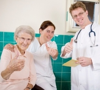 Doctor, nurse, and patient three thumbs up