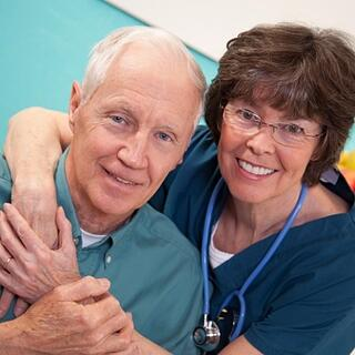 Nurse with elderly male patient